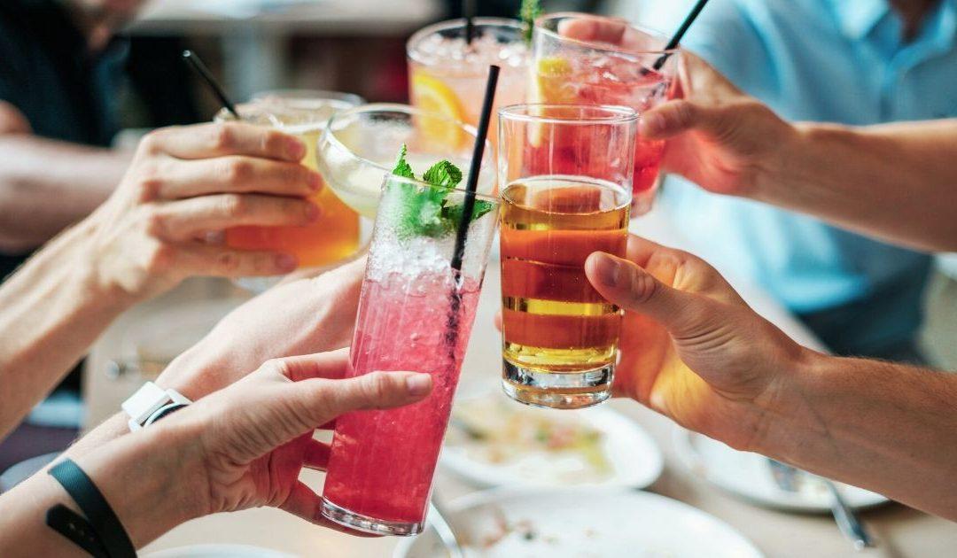 people cheering their drinks